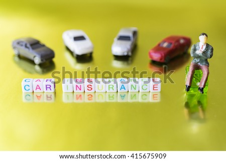 "Label word ""CAR INSURANCE"" written on plastic blocks, gold background with copyspace. - stock photo"
