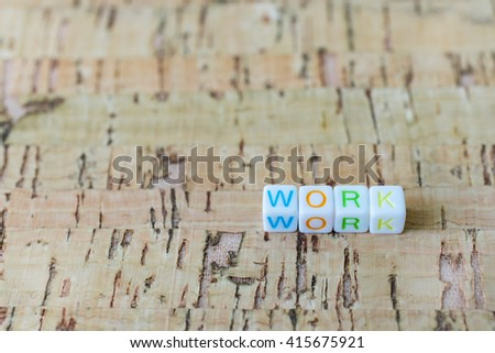 "Label word ""WORK"" written on plastic blocks, wood background with copyspace. - stock photo"