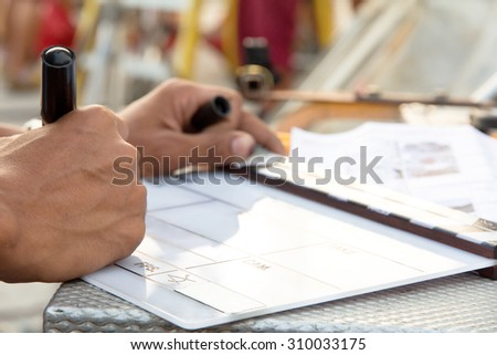 Labeling the Slate,film crew production set   - stock photo