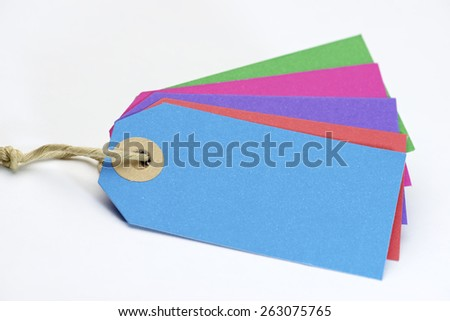 Labels with twine on a white table. - stock photo