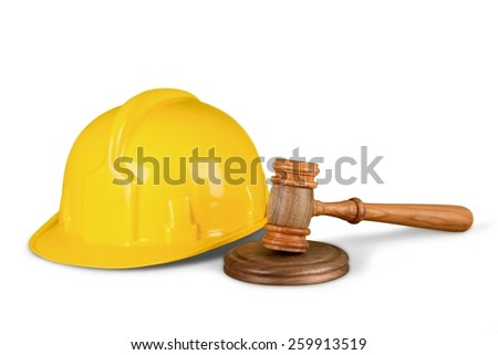 Labor law concept, wooden judge gavel and yellow helmet isolated on white background  - stock photo