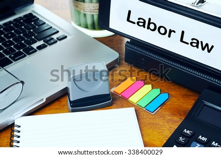 Labor Law - Office Folder on Office Desktop with Office Supplies. Business Concept on Toned and Blurred Background - stock photo