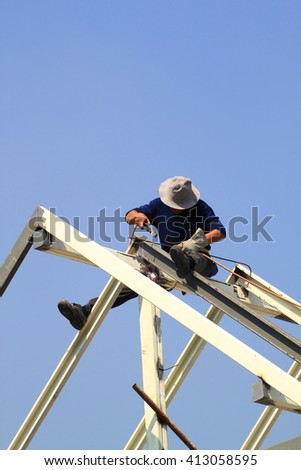 Labor on roof - stock photo