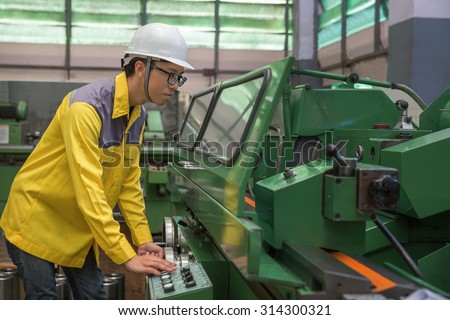 labor operation with a lathe, industrial machine tool used in metalworking - stock photo
