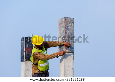Labor prepare Pillar cement with steel rod in construction site  - stock photo