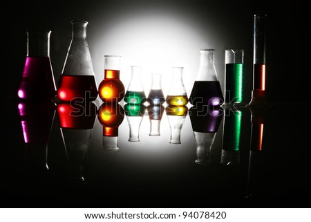Labor scene with testtubes and beaker - stock photo
