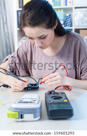 laboratory assistant girl  in electronic lab - stock photo