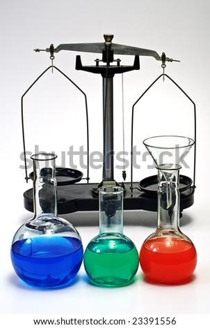 laboratory balance and glassware on white - stock photo