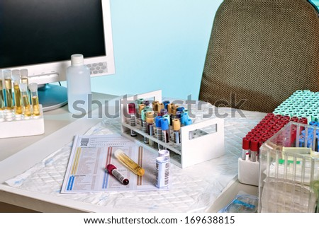 laboratory bench with blood and urine samples - stock photo