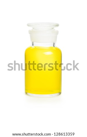 Laboratory bottle filled with yellow liquid - stock photo