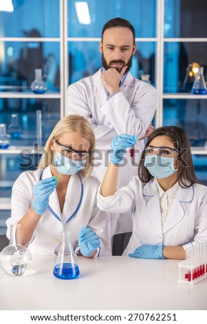 Laboratory, chemistry and science concept. Science team working in a laboratory. - stock photo