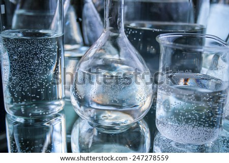 laboratory container on black background - stock photo