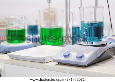 Laboratory equipment. Blue chemical substance in the beaker  - stock photo