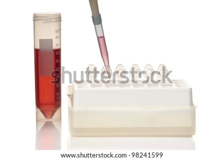 Laboratory equipment, tubes, pipette, rack. White background. Studio shot. - stock photo