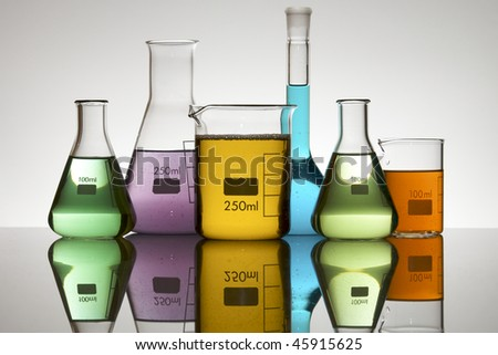 laboratory equipment with liquid color - stock photo
