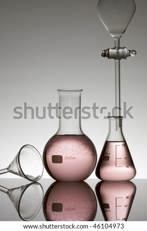 laboratory equipment with pink fluid - stock photo