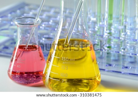 Laboratory flasks and test tubes with liquids of different colors - stock photo