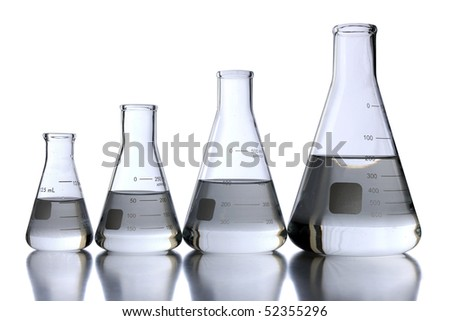 Laboratory flasks of different sizes over white background - With clipping path - stock photo