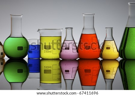 laboratory flasks with  brightly colored liquid inside - stock photo
