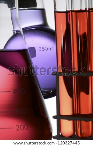 laboratory flasks with colored liquid chemical inside - stock photo