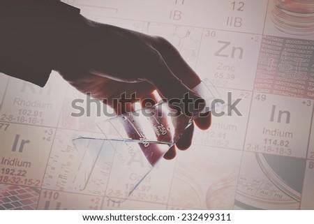 Laboratory glass in arm. Laboratory concept.  - stock photo