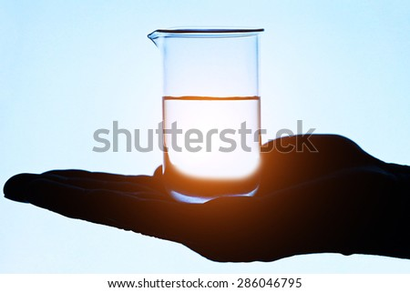 Laboratory glass on a arm. Laboratory concept.  - stock photo