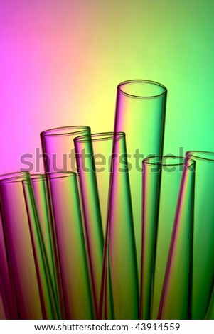 Laboratory glass test tubes over yellow with pink and green psychedelic background for a groovy experiment in a science research lab
