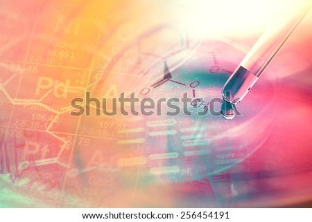 Laboratory glassware and DNA data. Science concept.  - stock photo
