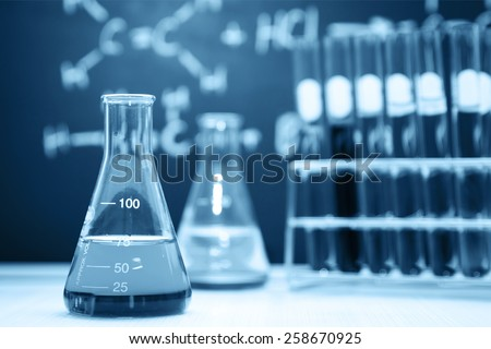 Laboratory glassware containing chemical liquid, Blue tone  - stock photo