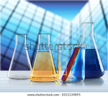 Laboratory glassware containing colorful chemical liquid