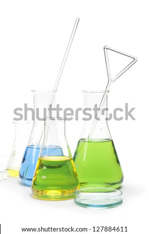 Laboratory glassware equipment. Laboratory beakers filled with colored liquid substances - stock photo