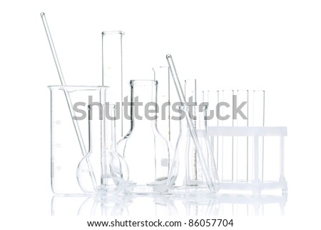 Laboratory glassware for liquids on white background - stock photo