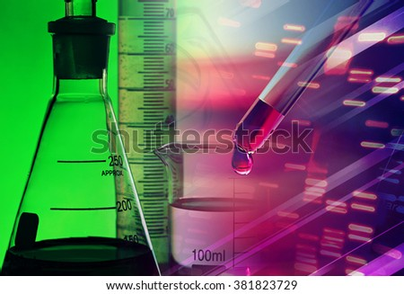 Laboratory glassware in green light. Science concept. - stock photo