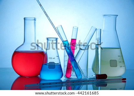 Laboratory glassware on blue background