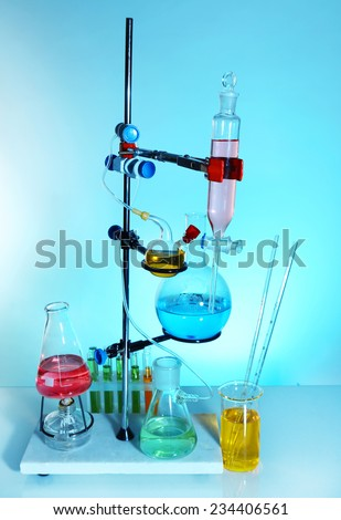 Laboratory glassware on light blue background