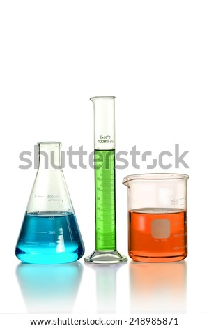 Laboratory glassware on table isolated over white background - With Clipping Path on Glassware - stock photo