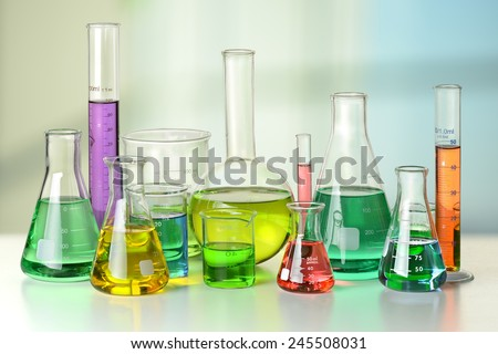 Laboratory glassware on white table and window in background - With Clipping Path on glassware - stock photo
