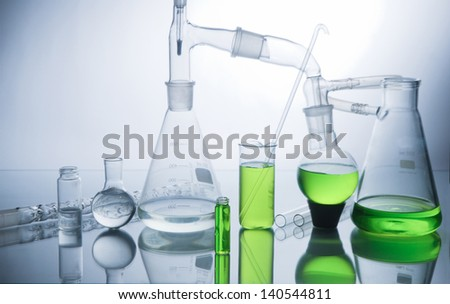Laboratory glassware  over white background - stock photo