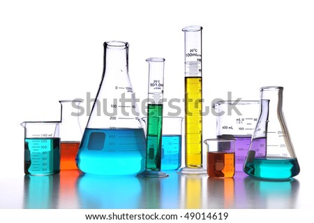 Laboratory glassware over white background with reflections on surface - stock photo