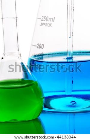 Laboratory glassware with analyzing liquid isolated over white background - stock photo