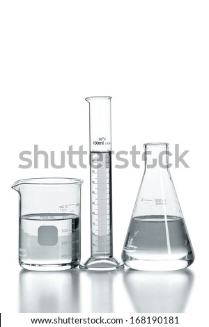 laboratory glassware with clear liquid isolated over white background - with clipping path on glass - stock photo
