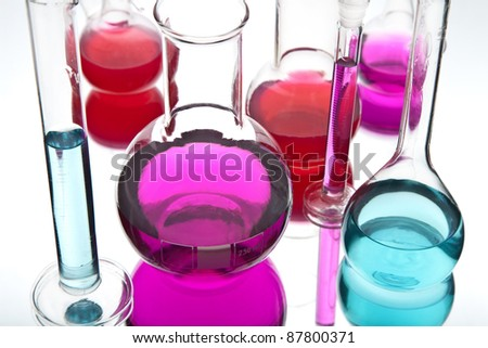 laboratory glassware with colorful chemicals - stock photo