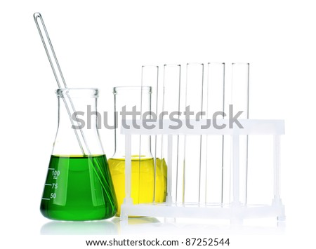 Laboratory glassware with colorful liquids and syringes on white background - stock photo
