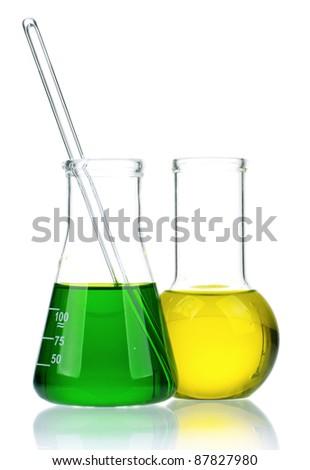 Laboratory glassware with colorful liquids on white background - stock photo