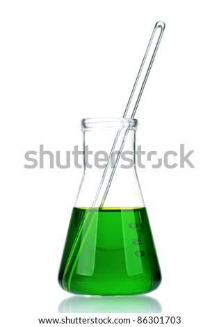 Laboratory glassware with green liquid on white background - stock photo