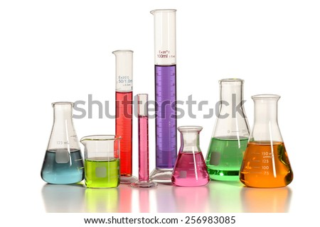 Laboratory glassware with liquids of different colors isolated over white background - With clipping path on glass - stock photo