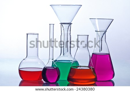 laboratory  glassware with solution  colorful - stock photo