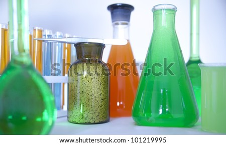 Laboratory glassware with various colored liquids  chemical glass - stock photo