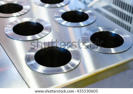 Laboratory heater for flasks. Metal plate with holes spaced bars. - stock photo