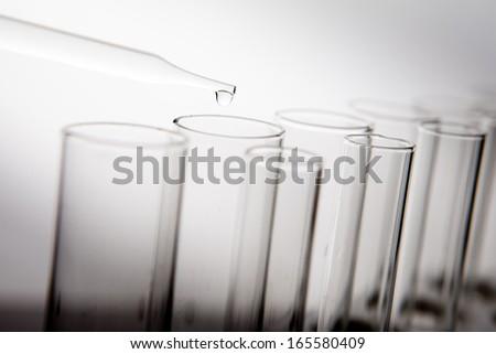 Laboratory Lab Tube in blue sample  - stock photo